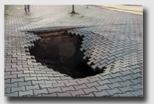 Unfortunately for the Commonwealth, not every hole in the street is this obvious.