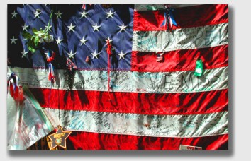 Celebrate and enjoy the 4th of July, honoring the purpose of the day. (Photo of flag hanging on the fence of St. Paul church, next to the World Trade Center, taken in spring 2002).